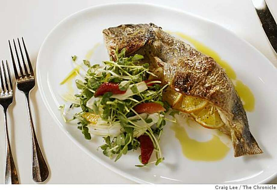 Wood Oven Roasted Whole Fish with Meyer Lemon at Bottega restaurant by chef Michael Chiarello in Yountville, Calif. Photo: Craig Lee, The Chronicle