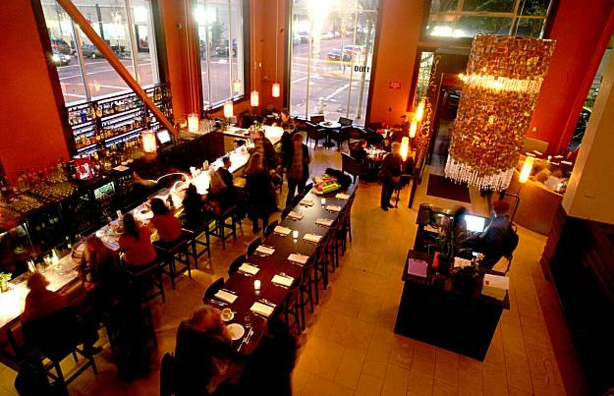 Guests enjoy the bar/dining area with chandelier (upper right) at Dosa in San Francisco, Calif., on Wednesday, January 28, 2009.