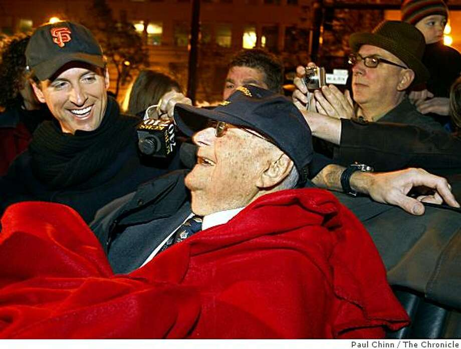 Mayor Gavin Newsom chats with 105-year-old Herbert Hamrol at the ceremony at Lotta's Fountain to commemorate the 102nd anniversary of the 1906 earthquake in San Francisco on Friday, April 18, 2008. Hamrol was a just 3-year-old when the big one struck. Photo: Paul Chinn, The Chronicle