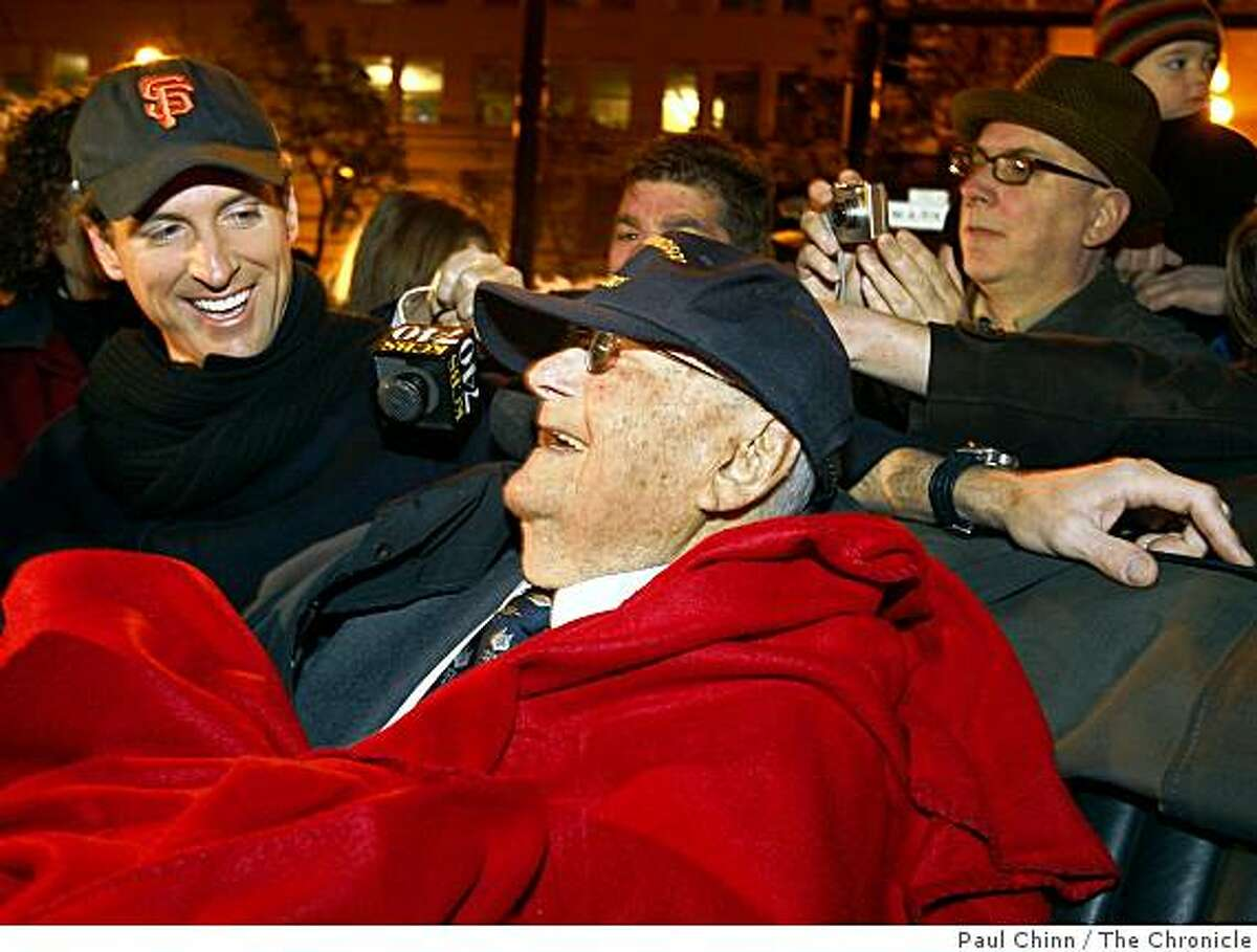 Mayor Gavin Newsom chats with 105-year-old Herbert Hamrol at the ceremony at Lotta's Fountain to commemorate the 102nd anniversary of the 1906 earthquake in San Francisco on Friday, April 18, 2008. Hamrol was a just 3-year-old when the big one struck.