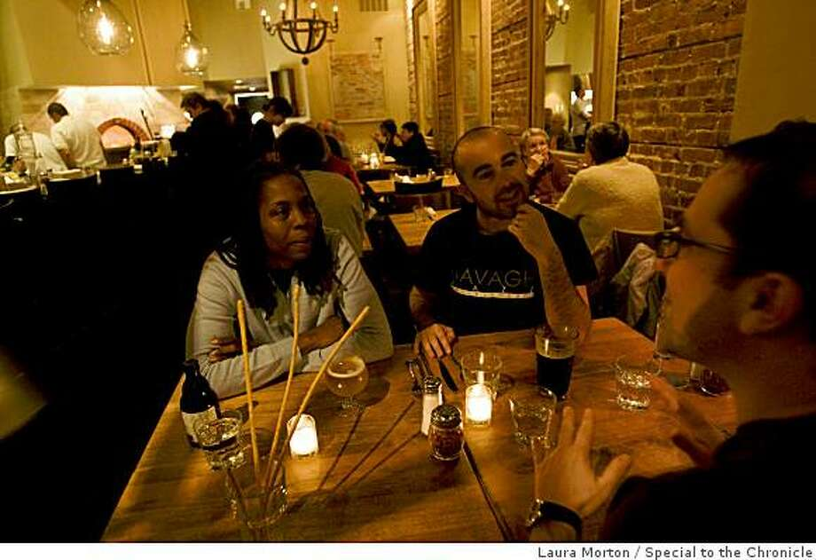 Karen Pape, Rob Pape and Nic Taylor (left to right) dine at Marzano, a cozy restaurant in Oakland, Calif., on Friday, January 16, 2008. Photo: Laura Morton, Special To The Chronicle