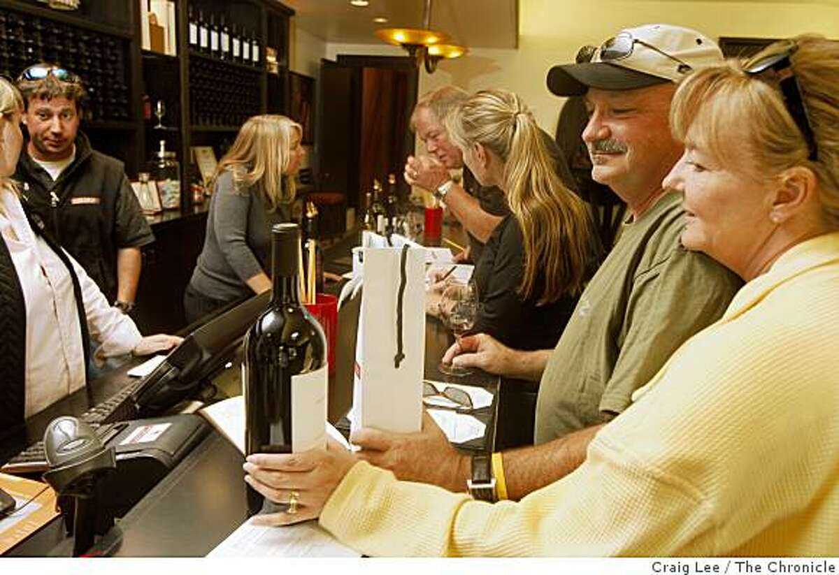 Annie Skradski (right) from Piedmont, Calif., with her brother, Tim Moynihan, visiting from Minnesota, at the Louis M. Martini winery taste room in St. Helena, Calif., on October 17, 2008. They bought a magnum bottle of Louis M. Martini, Lot 1 Cabernet Sauvignon.
