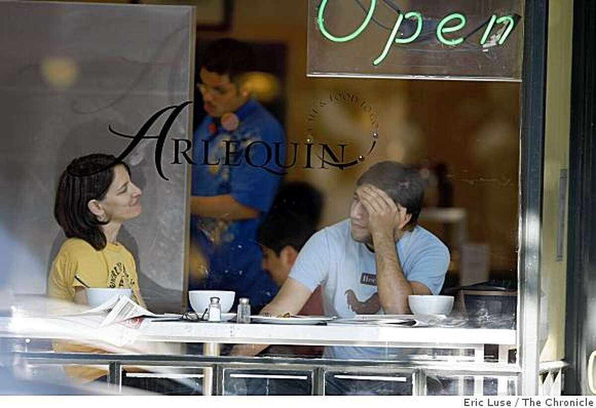 Esther Kaplan and David Barreda enjoy the morning in the window seat at Arlequin Cafe in San Francisco photographed on Tuesday, November 18, 2008.