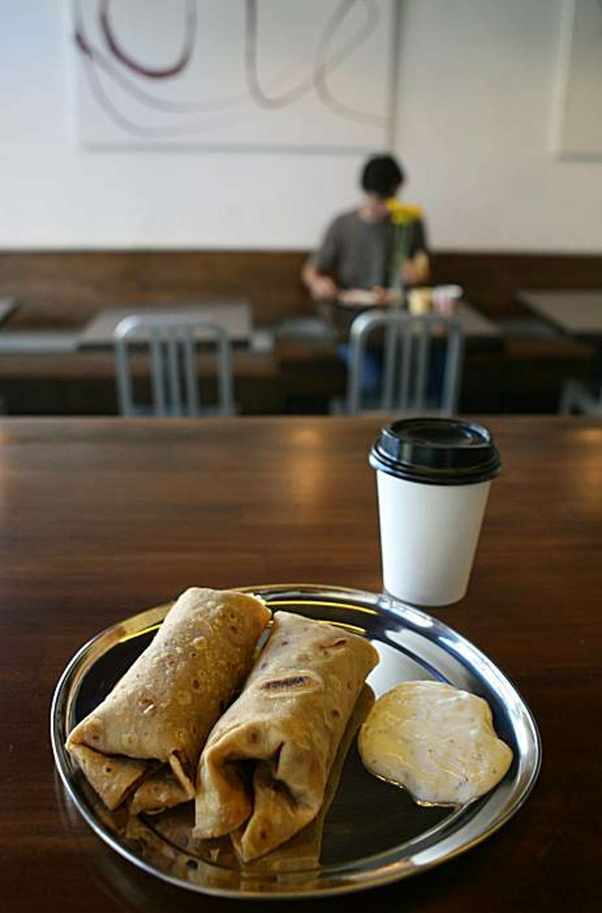 Kati roll plate and chai is photographed at Kasa Indian Eatery in San Francisco, Calif. on Friday, November 14, 2008