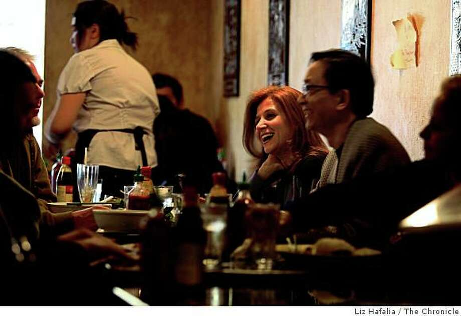 Aylin Yavuz (middle) and Gary Gee (middle, right) having a company lunch with co-workers at mission neighborhood Sunflower restaurant in San Francisco, Calif., on Monday, November 3, 2008. Photo: Liz Hafalia, The Chronicle