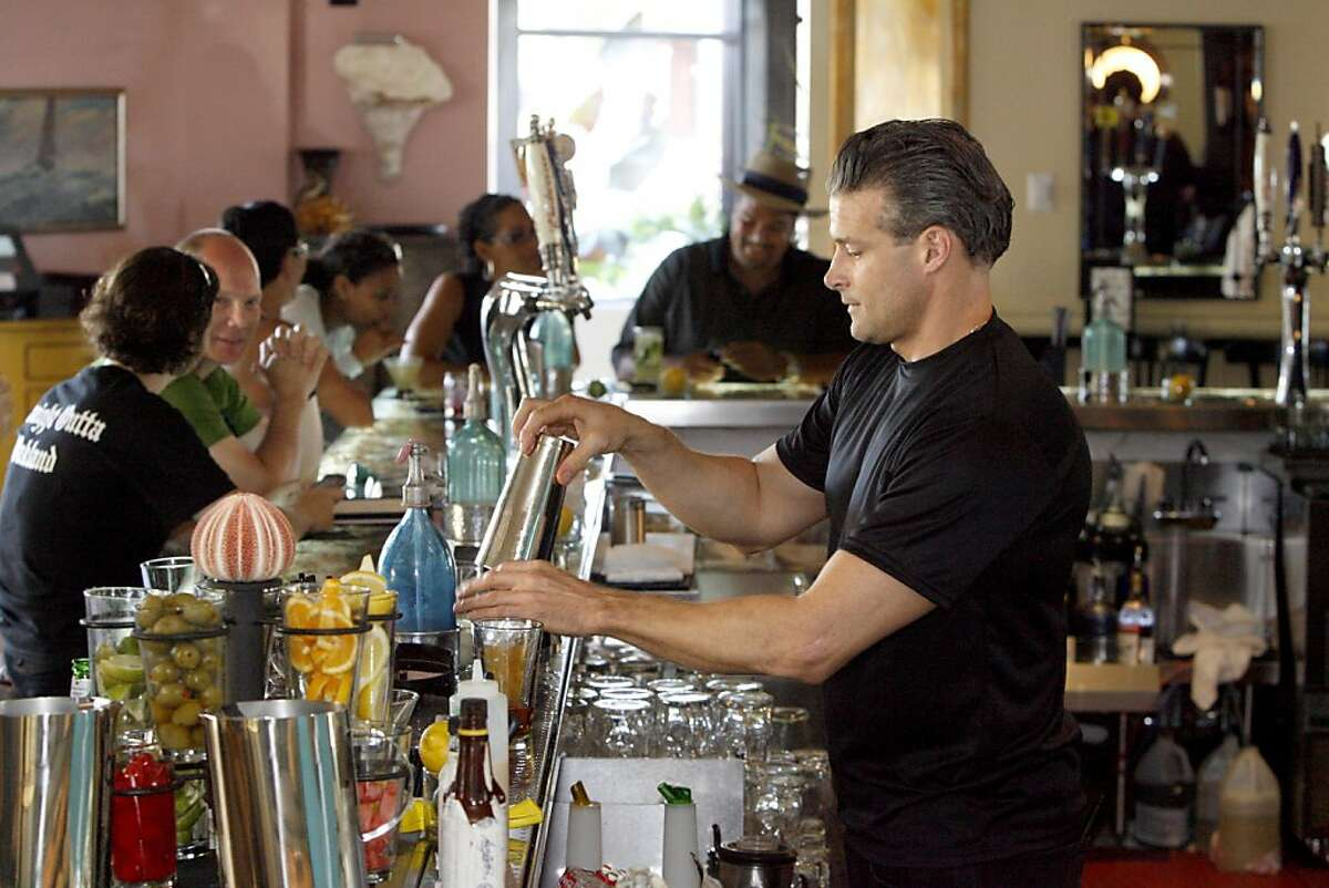 Keith Michael, right, tending the bar at Miss Pearl's Jam House in Jack London Square, in Oakland, Calif. on Sunday, Oct. 31, 2008.