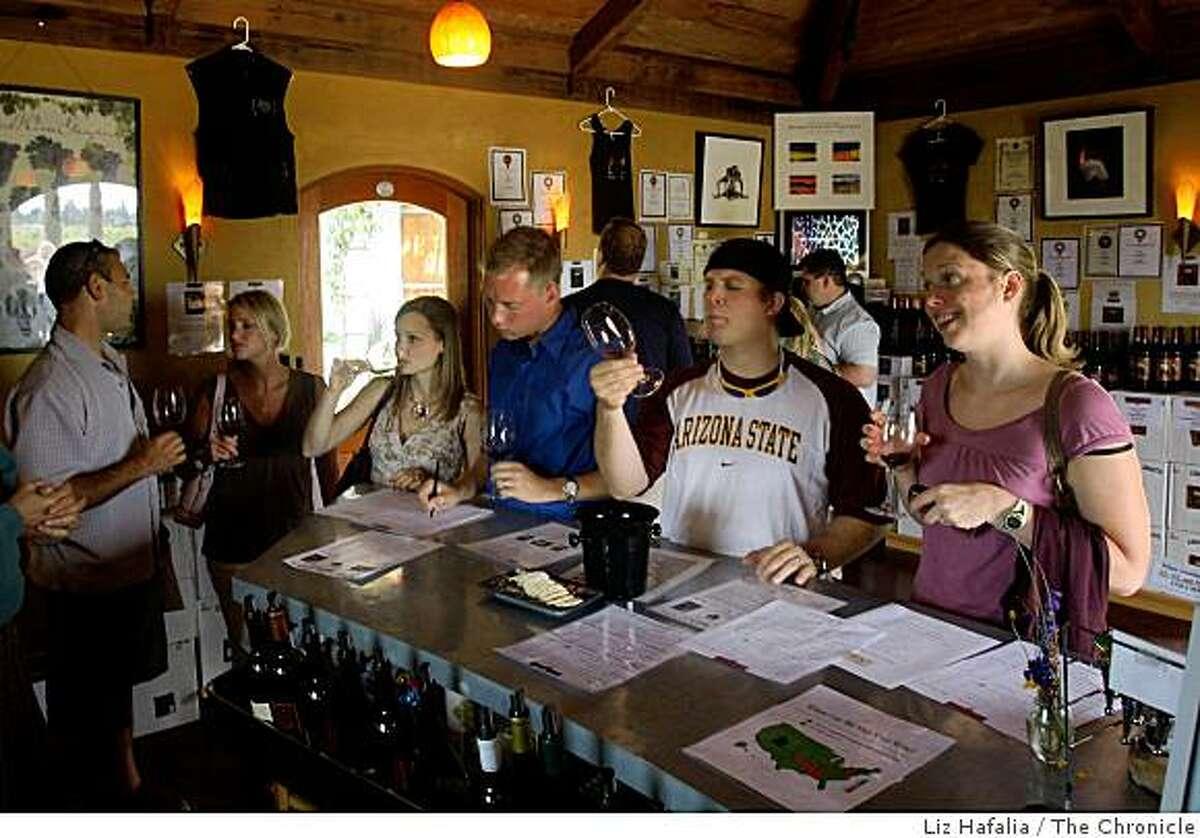 Lisa Giacumo-Jicha (left) and her husband Gottlieb Giacumo-Jicha (wearing baseball cap), from Arizona, doing a wine tasting at Hagafen Cellars tasting room in Napa, Calif., on Tuesday, August 5, 2008.