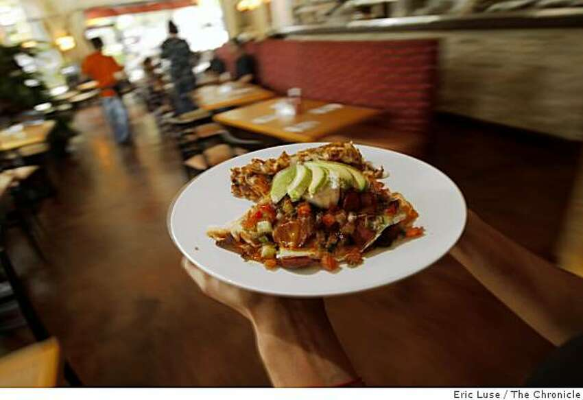 Waitress Bethanie Hines delivers a Mediterranean Scramble to a customer at Cafe M in Berkeley photographed on Thursday, October 2, 2008.