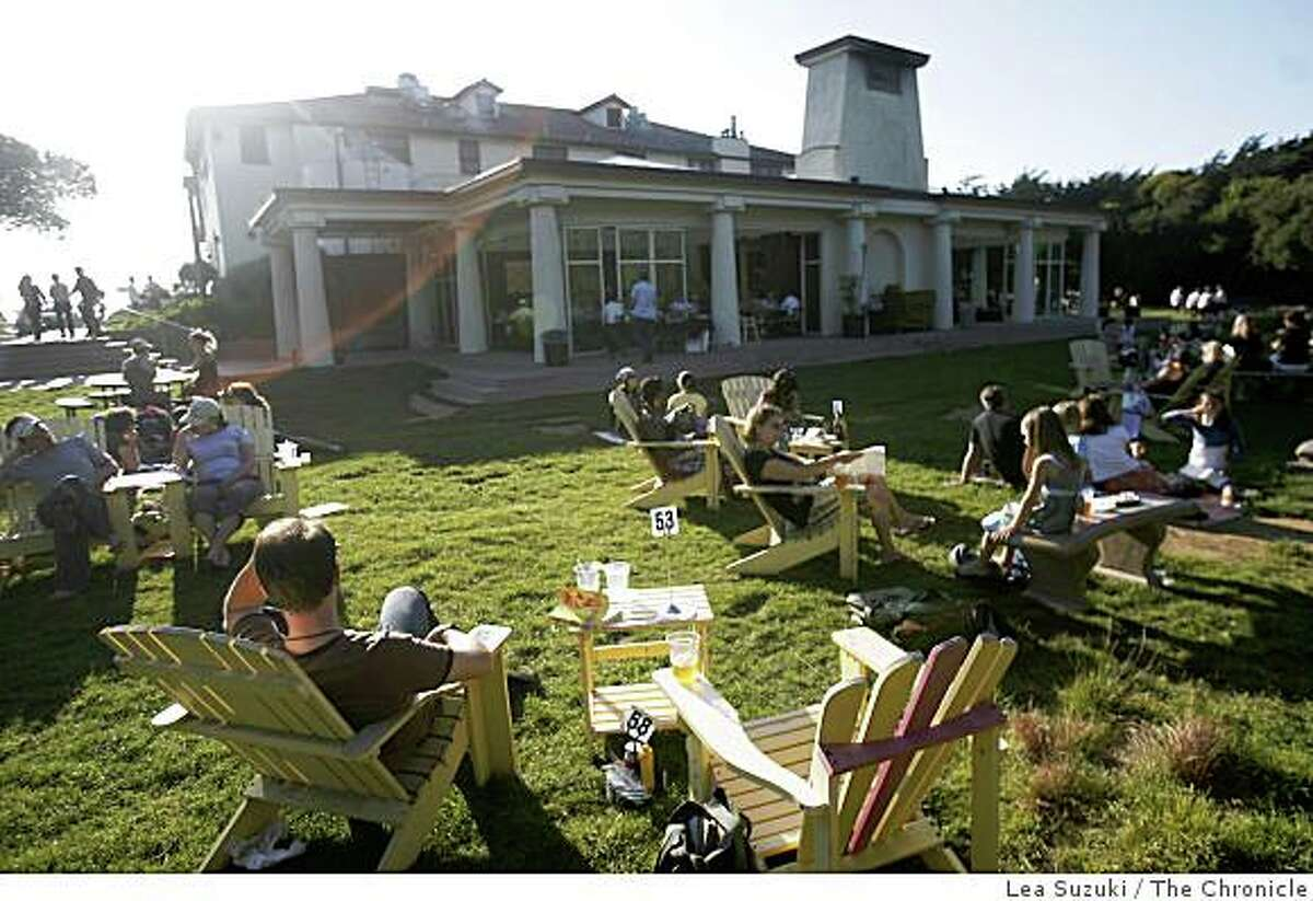 People enjoy the outside lawn seating at Park Chalet near San Francisco's Ocean Beach on Thursday August 28, 2008 in San Francisco, Calif.