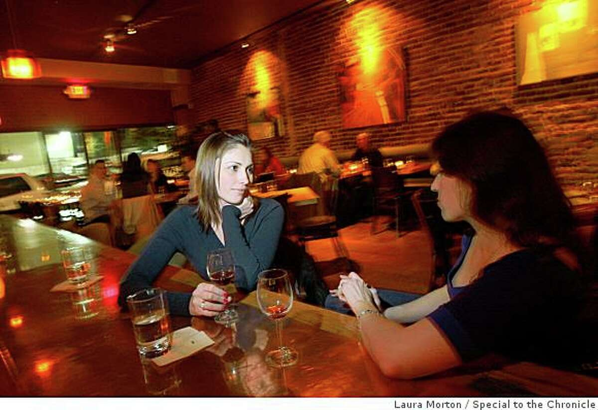 Laura Mitchell and Sarah Offenbach (right) enjoy a few drinks at Brick, a cozy restaurant and bar in San Francisco. (Laura Morton/Special to the Chronicle)