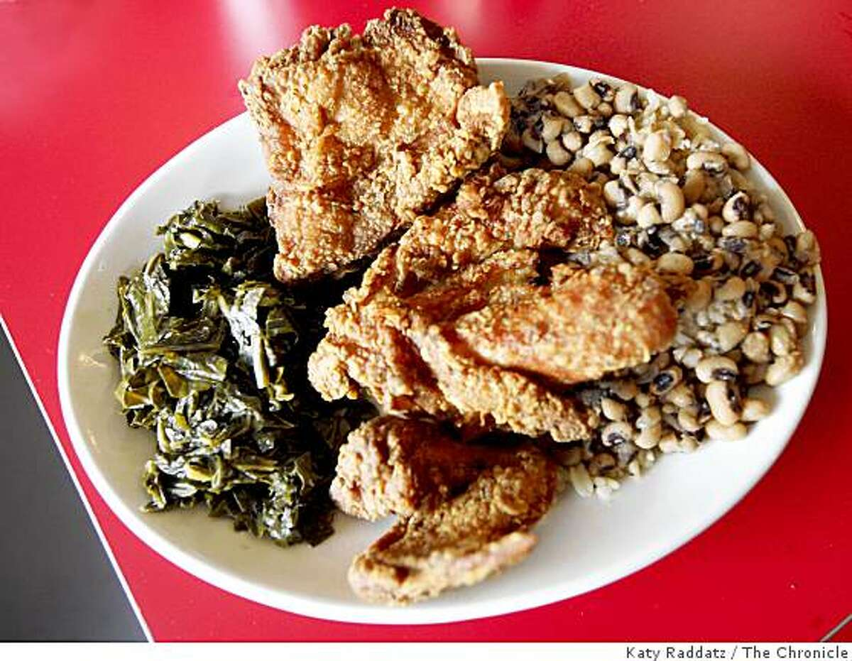 Fried chicken with sides of blackeyed peas and collard greens at the Hard Knox Cafe on Clement St., in San Francisco, CA.
