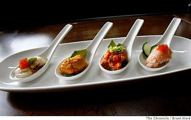 Left to right, small crudos of scallops, sea urchin, spicy tuna and crab are served in wonton spoons. Photo: Brant Ward, The Chronicle