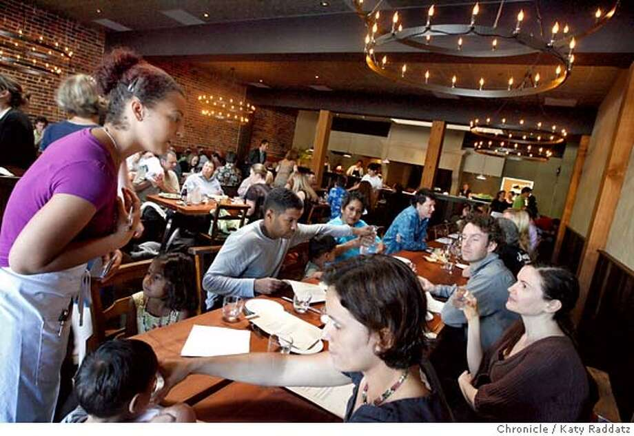 ###Live Caption:Waitress Jessica Moncada, left, takes care of diners at Camino, a new restaurant on Grand Ave. in Oakland, Calif. on Sunday May 18, 2008.  Katy Raddatz / The San Francisco Chronicle###Caption History:Waitress Jessica Moncada, left, takes care of diners at Camino, a new restaurant on Grand Ave. in Oakland, Calif. on Sunday May 18, 2008.  Katy Raddatz / The San Francisco Chronicle###Notes:Jessica Moncada###Special Instructions:MANDATORY CREDIT FOR PHOTOG AND SAN FRANCISCO CHRONICLE/NO SALES-MAGS OUT Photo: KATY RADDATZ