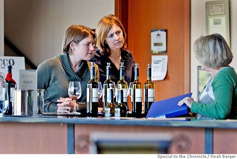 ###Live Caption:At Mazzocco winery, (l-r) Wendi Siebold and Keri Dertinger get some help with their wine choice from Charlotte Robinson. Tasting rooms in the Healdsburg, Sonoma County, area. (By Brant Ward/San Francisco Chronicle)###Caption History:At Mazzocco winery, (l-r) Wendi Siebold and Keri Dertinger get some help with their wine choice from Charlotte Robinson. Tasting rooms in the Healdsburg, Sonoma County, area. (By Brant Ward/San Francisco Chronicle)###Notes:###Special Instructions: Photo: Brant Ward