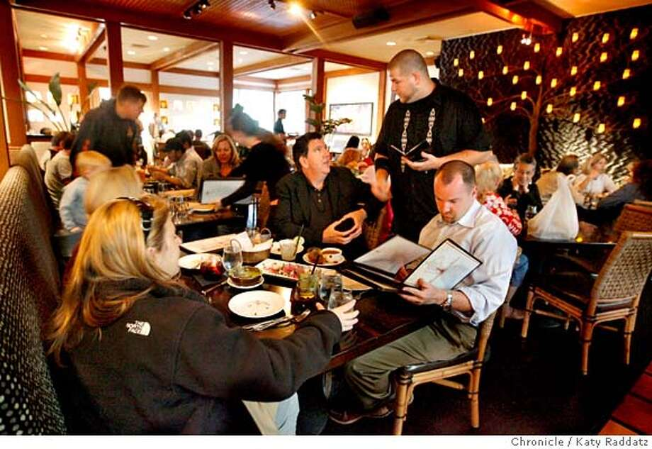 ###Live Caption:Waiter Dan Riley helps customers make choices at Maria Maria, a restaurant in Walnut Creek, Calif. on Tuesday, April 29, 2008.  Photo by Katy Raddatz / San Francisco Chronicle###Caption History:Waiter Dan Riley helps customers make choices at Maria Maria, a restaurant in Walnut Creek, Calif. on Tuesday, April 29, 2008.  Photo by Katy Raddatz / San Francisco Chronicle###Notes:Maria Maria, Dan Riley###Special Instructions:MANDATORY CREDIT FOR PHOTOG AND SAN FRANCISCO CHRONICLE/NO SALES-MAGS OUT Photo: KATY RADDATZ