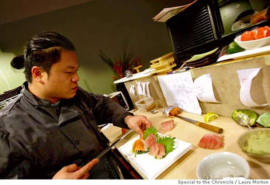 Sudachi owner Ming Hwang works behind the sushi bar at his San Francisco restaurant. (Laura Morton/Special to the Chronicle) Photo: Laura Morton