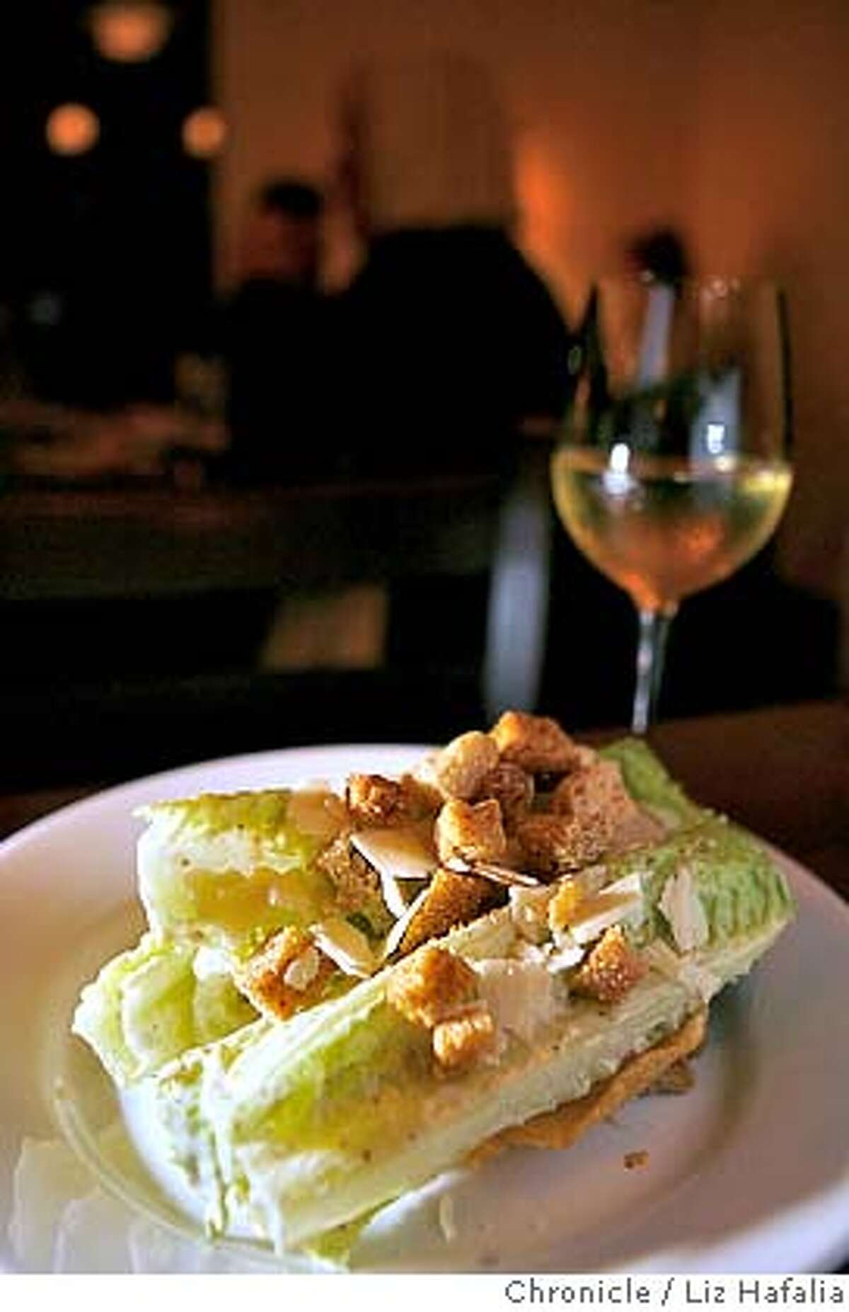 D.27GIGI_066_LH.jpg Caesar salad with garlic croutons and parmesan crisp at Gigi, a new restaurant in Lafayette done by Jeff Amber, a well known Bay Area chef. Liz Hafalia/The Chronicle/Lafayette/1/4/08 **Jeff Amber cq Ran on: 01-27-2008 Prudy Noon, Kumi Yamaguchi and Erin Dowd anticipate their meals at Gigi, which is run by Chronicle Rising Star chef Jeffrey Amber.