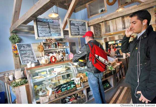 Customers wait for their lunch orders at the Blue Barn Gourmet Deli. It's a small but cute deli/takeout spot, at 2105 Chestnut St. near Steiner in San Francisco. The facade, which is built to resemble a barn, is carried inside offering a warm cozy feel. The restaurant is open from 11am-8pm Wednesday-Monday. By Lance Iversen/The Chronicle Photo: Lance Iversen