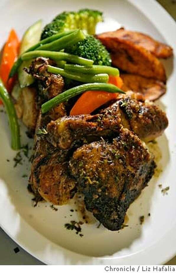 Jerked chicken at soul food restaurant Back-A-Yard in Menlo Park. Photo: Liz Hafalia