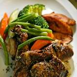 DINE19_back_038_LH.JPG Jerked chicken at soul food restaurant Back-A-Yard in Menlo Park. Liz Hafalia/The Chronicle/San Francisco/12/14/07  ** cq �2007, San Francisco Chronicle/ Liz Hafalia  MANDATORY CREDIT FOR PHOTOG AND SAN FRANCISCO CHRONICLE. NO SALES- MAGS OUT.