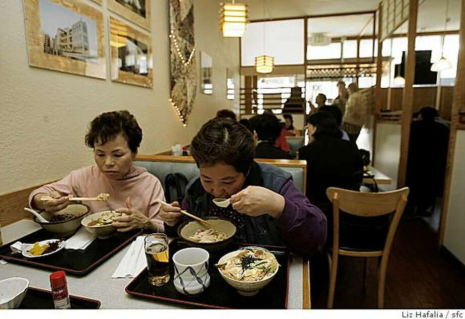 At left is Teruko Nishimoto having hot soba and at right is Emiko Doerner having hot noodles at Hotaru, a Japanese restaurant in San Mateo. Photo: Liz Hafalia, Sfc