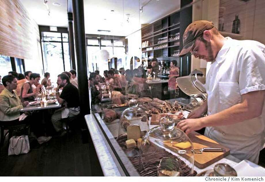 "� d.05BARBAMBINO_121_KK.JPG Barbambino Cafe and Wine Bar at 2931 16th St. in San Francisco features Italian dishes and has a ""Formaggi e Salumi"" chef who serves up imported and artisan meats and cheeses. Alex Potter (right) the title of ""meat and cheese guy. Photo by Kim Komenich/The Chronicle **Alex Potter MANDATORY CREDIT FOR PHOTOG AND SAN FRANCISCO CHRONICLE. NO SALES- MAGS OUT. Photo: Kim Komenich"