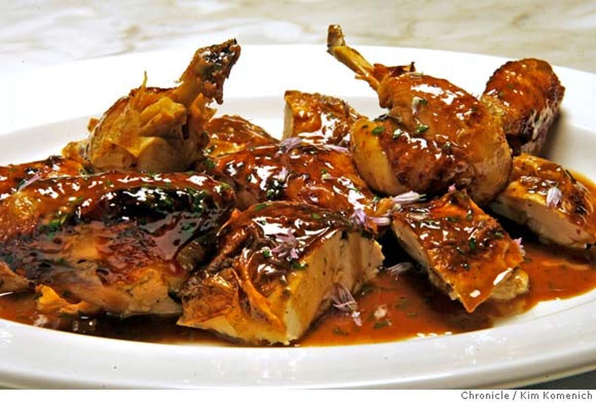 � d.22BARBERS_062_KK.JPG Review of Barber's Q, a barbecue restaurant in Napa. This is Fulton Farms Roasted VInegar Chicken sprinkled with chive blossoms. Photo by Kim Komenich/The Chronicle MANDATORY CREDIT FOR PHOTOG AND SAN FRANCISCO CHRONICLE. NO SALES- MAGS OUT.