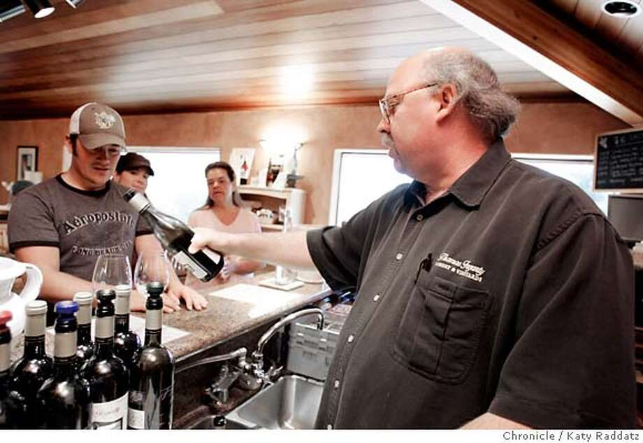 TASTINGROOMS_SANTACRUZ_021_RAD.jpg SHOWN: Thomas Fogarty Winery and Vineyard at 19501 Skyline Bl. in Woodside. Rick Davis, the tasting room mgr. pouring Chardonnay for Caleb Felton and his family from Mt. View. These pictures were made in Woodside, CA. on Sunday March 18, 2007.  (Katy Raddatz/The Chronicle) **Thomas Fogarty, Caleb Felton Mandatory credit for the photographer and the San Francisco Chronicle. No sales; mags out. Photo: Katy Raddatz