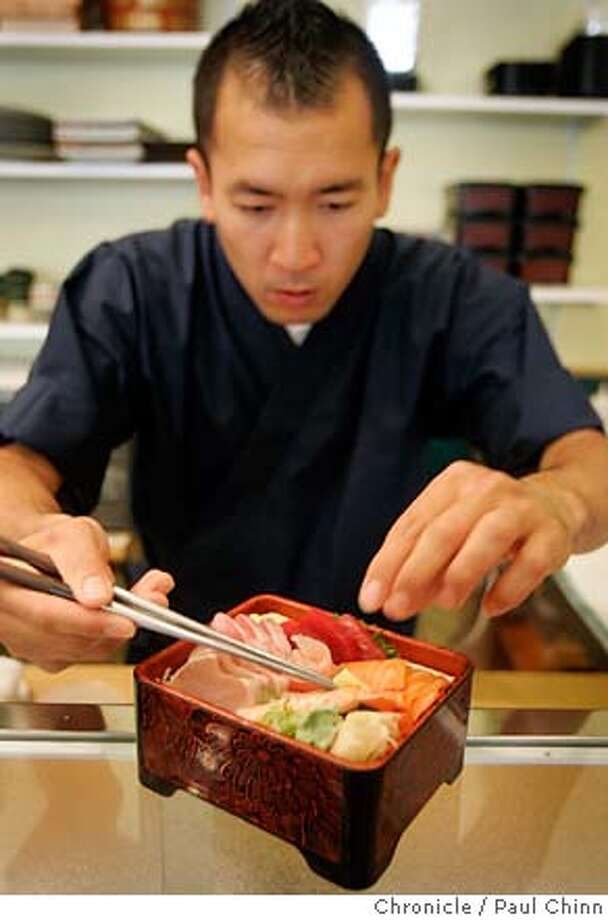 Chef Sean Buyan adds the finishing touches to an order of chirashi sushi at Musashi Japanese restaurant in Berkeley, Calif. on Tuesday, June 19, 2007.  PAUL CHINN/The Chronicle  **Sean Buyan MANDATORY CREDIT FOR PHOTOGRAPHER AND S.F. CHRONICLE/NO SALES - MAGS OUT Photo: PAUL CHINN