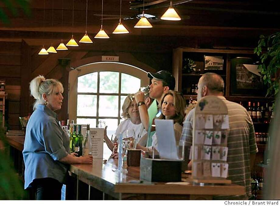 tastingroom032.JPG  The tasting bar at Sutter Home is long and roomy...many visitors try the famous White Zinfandel.  The Sutter Home winery tasting room just off highway 29 in St. Helena features a long tasting bar area, clothing, and menu items that go with their wide selection of wines.  {Brant Ward/San Francisco Chronicle}5/8/07 Photo: Brant Ward