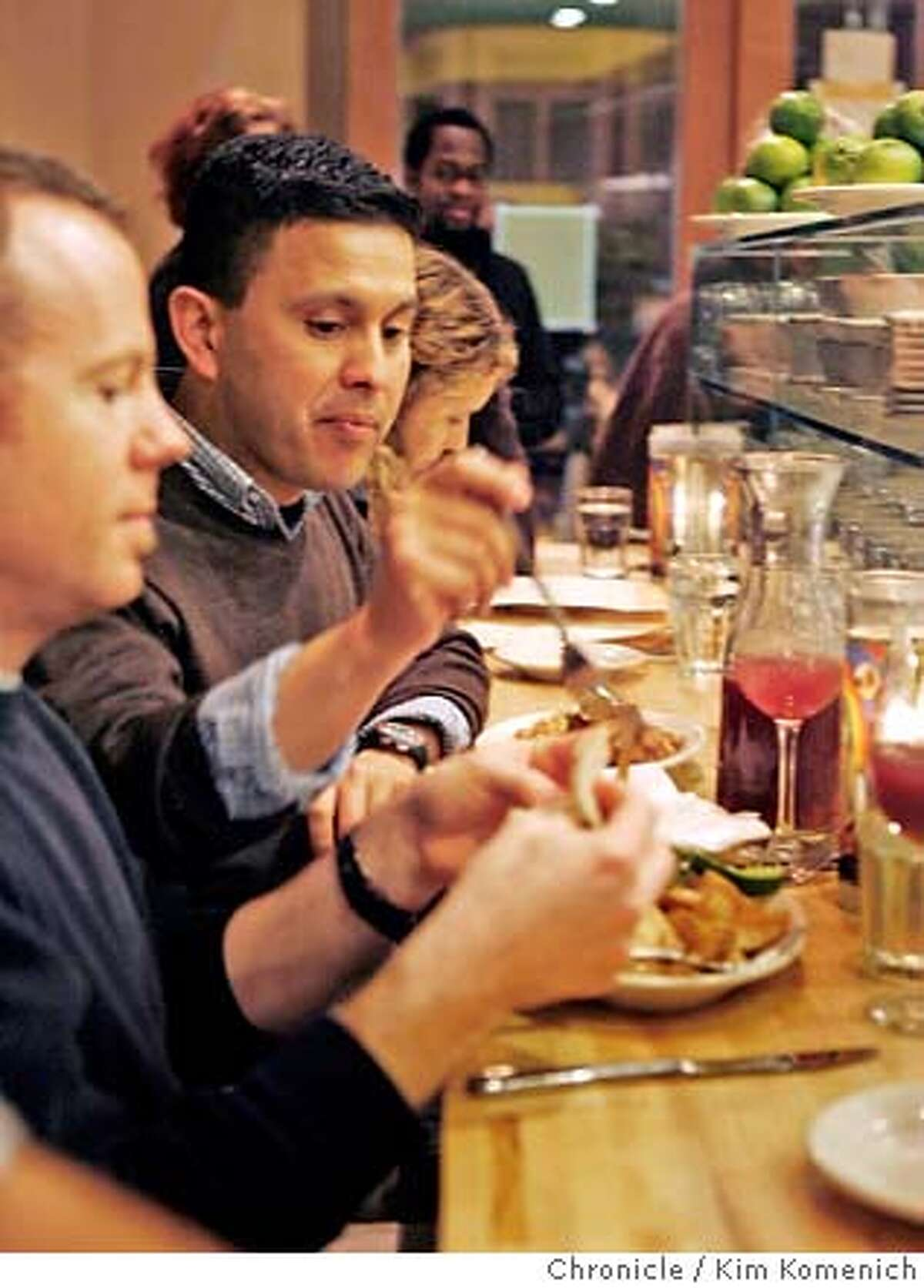 DINE18_048_KK.JPG Peter Chase, left, and Fernndo Castano have a meal at Regalito Rosticeria, a restaurant in the Mission District famous for using free range chicken and Niman Ranch beef in its Mexican dishes. Photo by Kim Komenich/The Chronicle **Peter Chase, Fernando Castano �2007, San Francisco Chronicle/ Kim Komenich MANDATORY CREDIT FOR PHOTOG AND SAN FRANCISCO CHRONICLE. NO SALES- MAGS OUT.