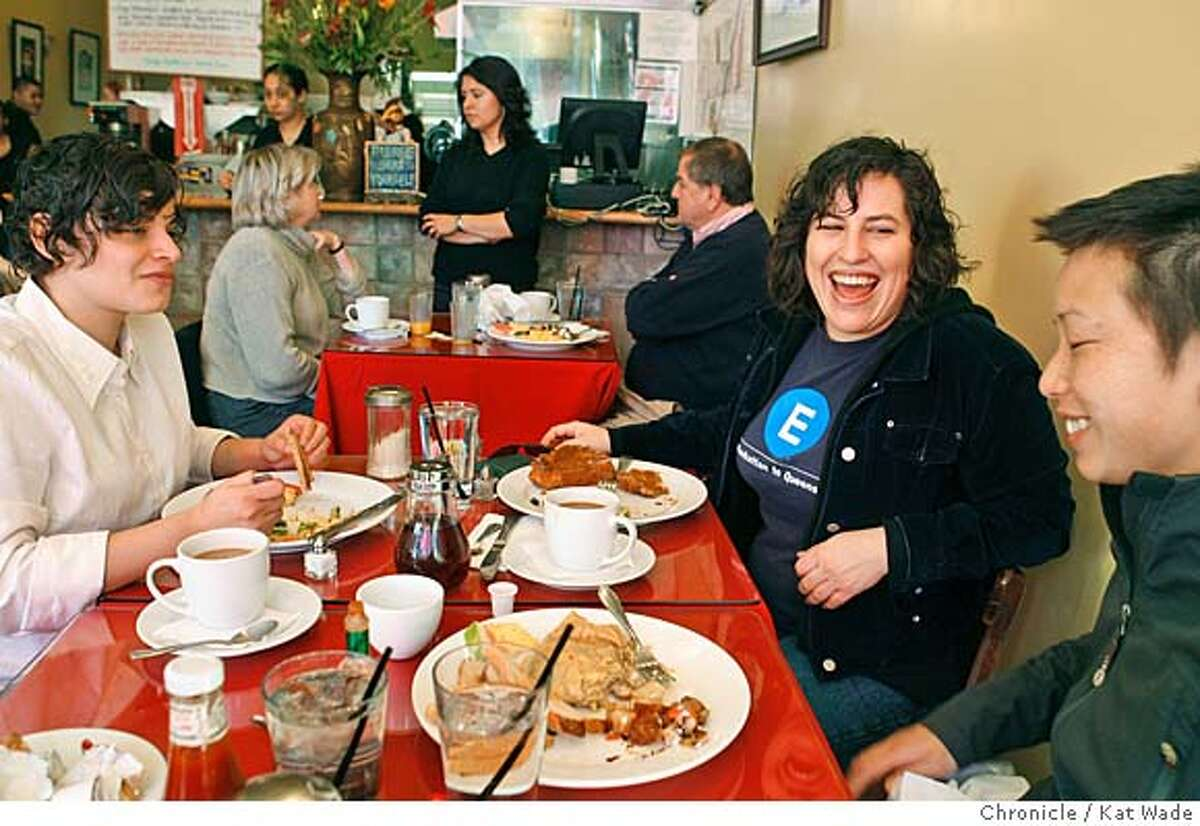 BARGAINBITE_033_KW_.jpg (L to R) Maricella Herrera and Claudia von Vacano (CQ) from Oakland eat breakfast at Cock-A-Doodle Cafe in Oakland on Washington Street that hustles and bustles with the Sunday crowd January 21, 2007. In the background Hostess Ana Trujillo chats with customers Shari and Dave Dunn of Oakland. Kat Wade/The Chronicle Mandatory Credit for San Francisco Chronicle and photographer, Kat Wade, Mags out