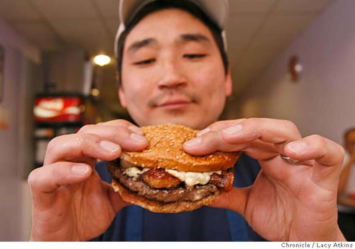 Pearl's Deluxe Burgers, is your basic burger joint with a special Prized Pearl burger (with bacon, blue cheese, etc.) and owner John Yee, Wednesday January 10, 2007 inSan Francisco,Ca. (Lacy Atkins/The Chronicle) MANDATORY CREDITFOR PHOTGRAPHER AND SAN FRANCISCO CHRONICLE/ -MAGS OUT