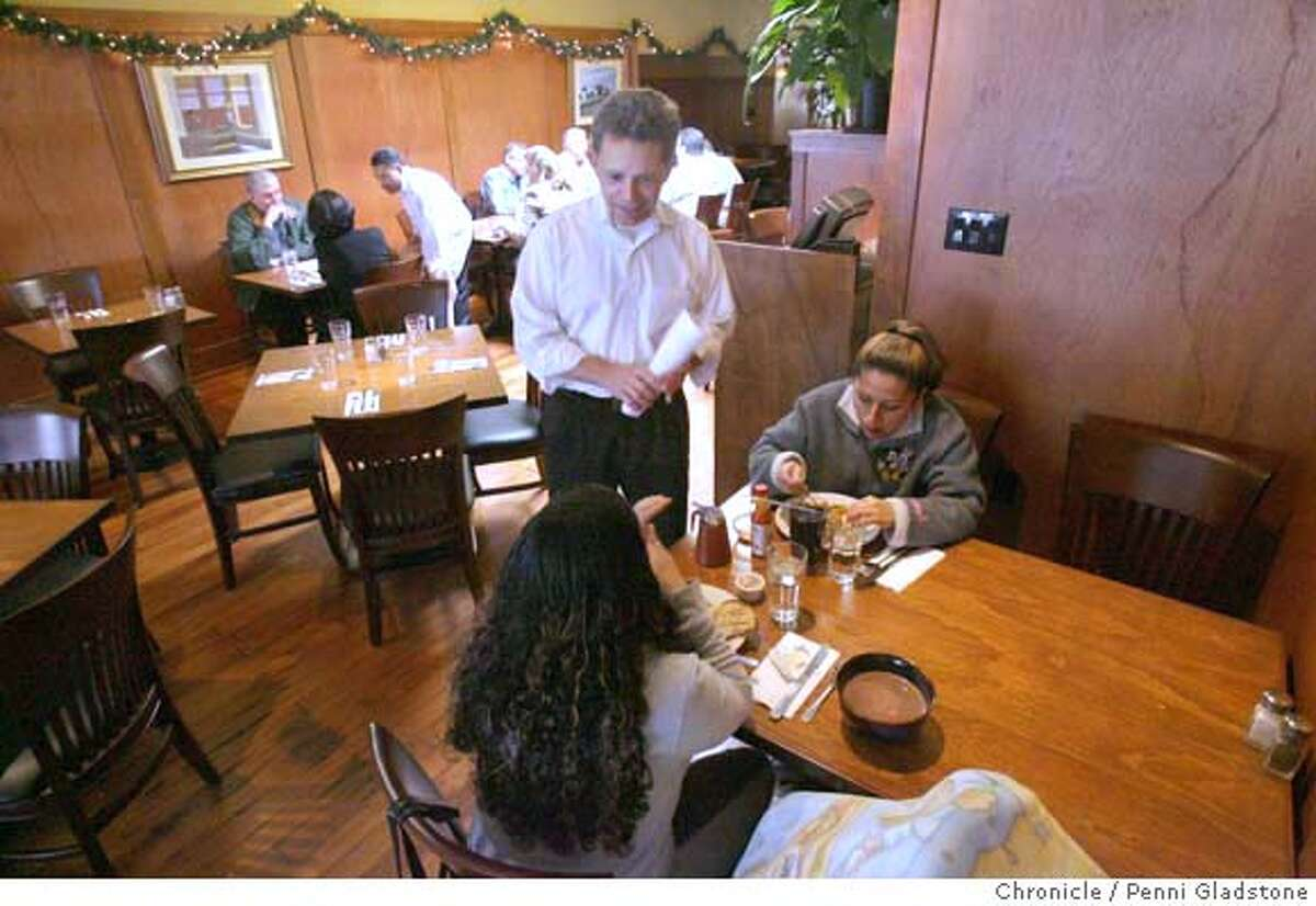 DINE22_somerset Gary Rizzo, owner of Somerset restaurant in Oakland talks to lunch guests. Event on 12/19/06 in Oakland. Penni Gladstone / The Chronicle MANDATORY CREDIT FOR PHOTOG AND SF CHRONICLE/ -MAGS OUT