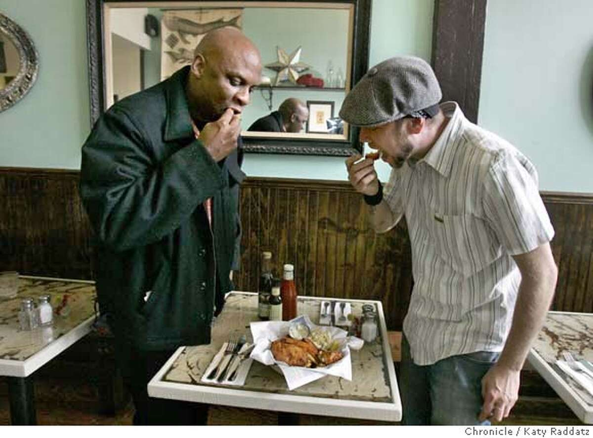 DINE15_WEIRDFISH_027_RAD.jpg SHOWN: L to R; Eddie Blyden, the chef at the Magnolia Pub on Haight St. has dropped in to sample Weird Fish's food--owner Timothy Holt and Eddie both sample the Fish and Chips. The name of the restaurant is Weird Fish. It's at 2193 Mission St. in San Francisco. These photos were made on Tuesday, Dec. 12, 2006, in San Francisco, CA. (Katy Raddatz/SF Chronicle) *Timothy Holt, Eddie Blyden Mandatory credit for the photographer and the San Francisco Chronicle. ; mags out.