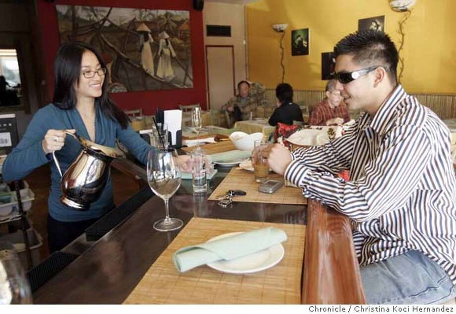 Vi Nguyen serves customer, Tuan Lenh, during lunch. Vanessa's Bistro, in Berkeley.(CHRISTINA KOCI HERNANDEZ/THE CHRONICLE) Mandatory Credit For Photographer and San Francisco Chronicle/No-Sales-Mags Out Photo: Christina Koci Hernandez