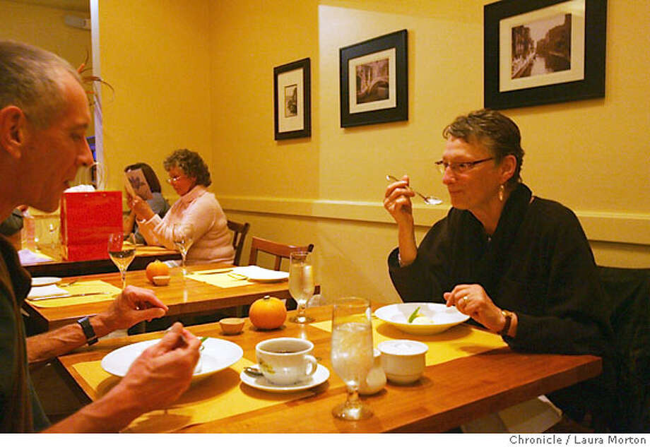 Alan Ernat (left) and Jean Tuckerman (right) dine at Barolo, a new restaurant in Pacifica, CA. Photo: Laura Morton
