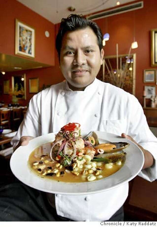 DINE08_MOCHICA_014_RAD.jpg  SHOWN: Carlos Altamirano, the owner and chef of Mochica, a small, upscale Peruvian restaurant in SoMa on Harrison St. between 5th and 6th Sts. Carlos Altamirano is holding one of his special dishes: Ceviche Mixto. These photos were shot on Wednesday, Sept. 6, 2006, in San Francisco, CA. (Katy Raddatz/The S.F.Chronicle)  **Carlos Altamirano, Mochica Mandatory credit for photographer and the San Francisco Chronicle/ -Mags out Photo: Katy Raddatz