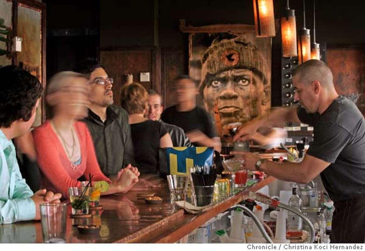 Patrons enjoy the bar at the new,