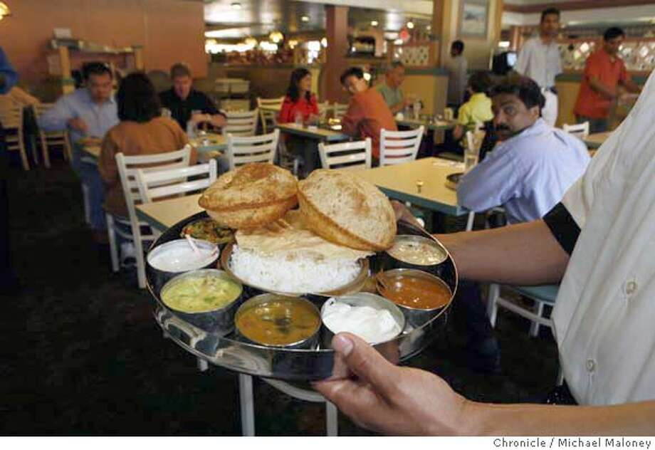The Saravanaa Special Meal is a good choice for a variety of South Indian samples such as sweet pooori, curry channa masala, rice, sambar, rasam, kulambu, two vegetable curries,raitha, curd appalam and pickles.  Saravana Bhavan is a popular South Indian restaurant located in what was once a Coco's restaurant in Sunnyvale specializing in vegetarian cuisine. Photo by Michael Maloney / San Francisco Chronicle on 6/28/06 in SUNNYVALE,CA MANDATORY CREDIT FOR PHOTOG AND SF CHRONICLE/ -MAGS OUT Photo: Michael Maloney