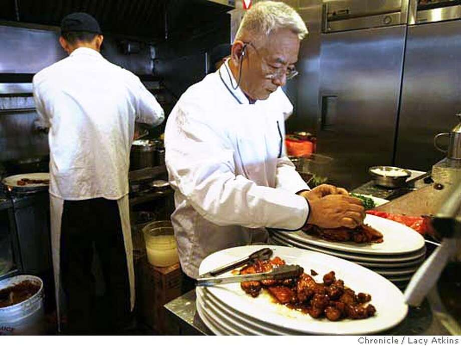 San Francisco's classic Chinatown restaurant House of Nanking chef-owner, Peter Fang prepares his special dish Nanking sesame chicken, Sunday June 18, 2006, in San Francisco, Ca. (Lacy Atkins/The Chronicle) MANDATORY CREDITFOR PHOTGRAPHER AND SAN FRANCISCO CHRONICLE/ -MAGS OUT Photo: Lacy Atkins