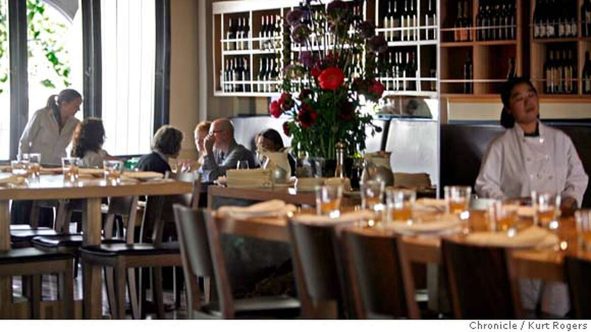 The dining area inside Terzo. Terzo is the third venture from the people who own Rose Pistola and Rose's cafe. They've created a stylish small-plate restaurant in the Marina KURT ROGERS SAN FRANCISCO THE CHRONICLE SFC .jpg MANDATORY CREDIT FOR PHOTOG AND SF CHRONICLE / -MAGS OUT
