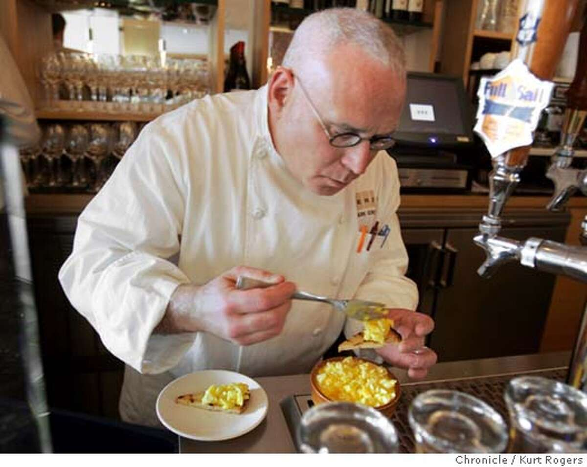 Behind the bar chef Mark Gordon prepares Soft Cooked Egg & Auruga on toast for the photo shoot. Terzo is the third venture from the people who own Rose Pistola and Rose's cafe. They've created a stylish small-plate restaurant in the Marina KURT ROGERS SAN FRANCISCO THE CHRONICLE SFC .jpg MANDATORY CREDIT FOR PHOTOG AND SF CHRONICLE / -MAGS OUT ------------------------------------------------------------------------