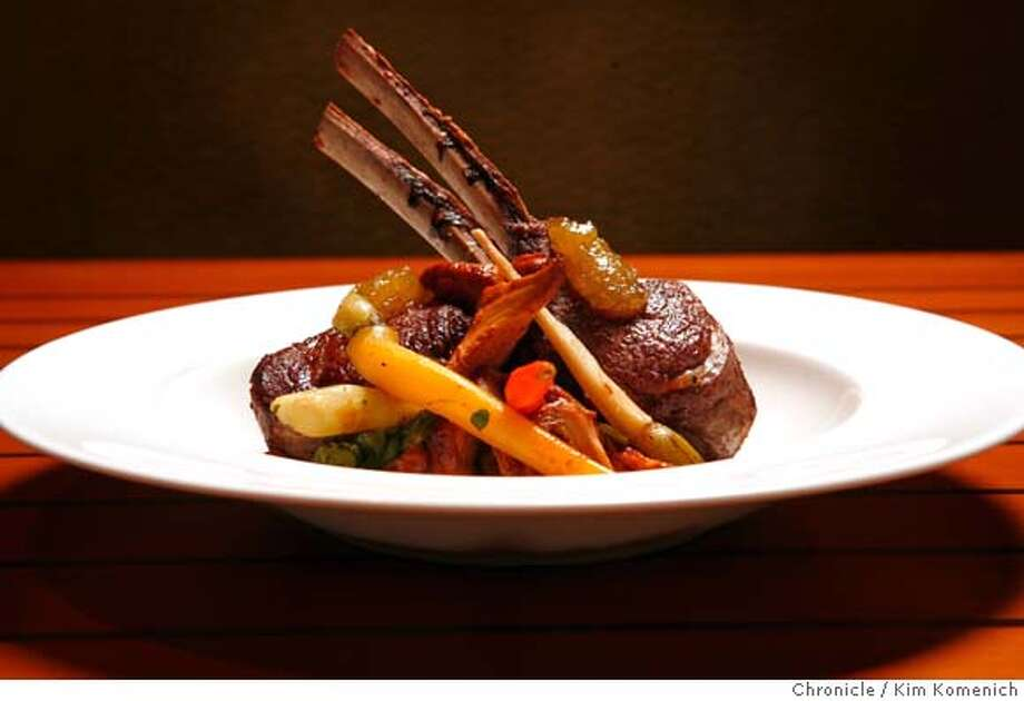 .JPG  This is is Quattro's grilled Colorado lamb chops aith fava beans, chantarelle mushrooms, heirloom carrots and fig mostarda.  Restaurant review of Quattro at the East Palo Alto Four Seasons Hotel. Alessandro Cartumini is the executive chef.  San Francisco Chronicle photo by Kim Komenich  4/11/06 �2006, Kim Komenich/The San Francisco Chronicle Photo: Kim Komenich