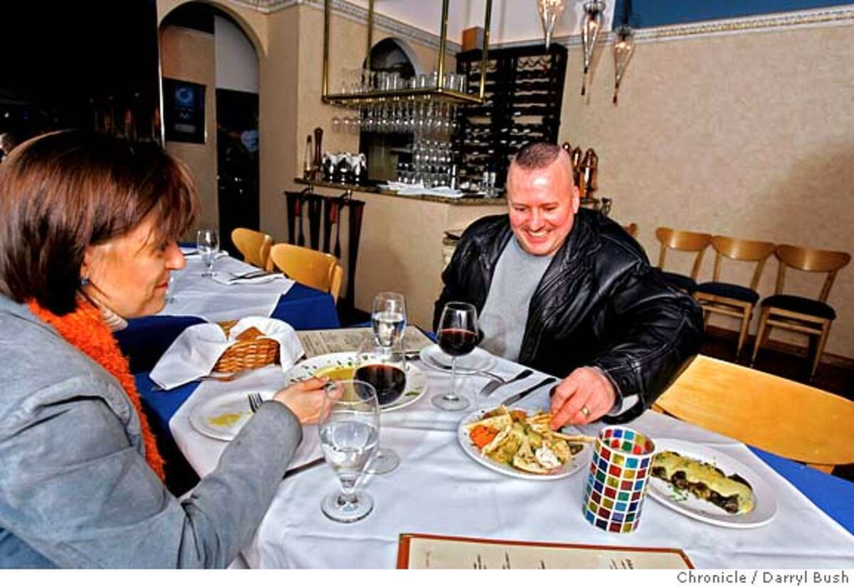 dining17_0060_db.JPG John and Lydia Damian of Napa enjoy dining at Estia Restaurant, a small Greek restaurant in North Beach. Event on 3/15/06 in San Francisco. Darryl Bush / The Chronicle MANDATORY CREDIT FOR PHOTOG AND SF CHRONICLE/ -MAGS OUT
