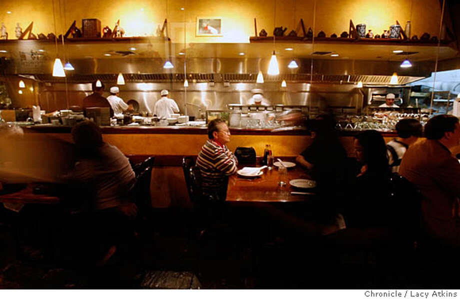 Kirin is a northern Chinese restaurant where the glass enclosed kitchen allows the crowd in the dining room to watch the cooking without the smell of a working kitchen, in Berkely, Feb, 23, 2006.Photo By Lacy Atkins MANDATORY CREDIT FOR PHOTOG AND SF CHRONICLE/ -MAGS OUT Photo: LACY ATKINS