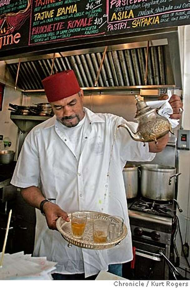 Mohammed pours glasses of mint tea Tajine a small Moroccan food restaurant that serves very good food Mohammed Ghaleb is the owner.  TAJINE10_0102_kr.JPG 8/3/05 in San Francisco,CA.  KURT ROGERS/THE CHRONICLE MANDATORY CREDIT FOR PHOTOG AND SF CHRONICLE/ -MAGS OUT Photo: KURT ROGERS