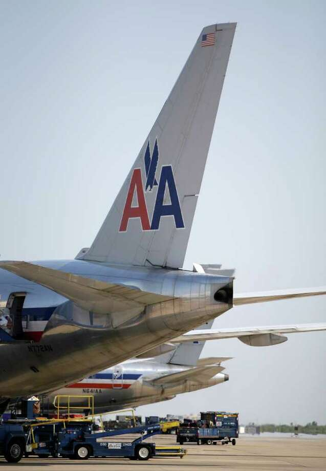 In this June 29, 2011 photo, American Airlines aircraft sit at Terminal D gates at Dallas-Fort Worth International Airport, in Grapevine, Texas. American Airlines and American Eagle's parent companies are filing for Chapter 11 bankruptcy protection Tuesday, Nov. 29, 2011. Photo: AP