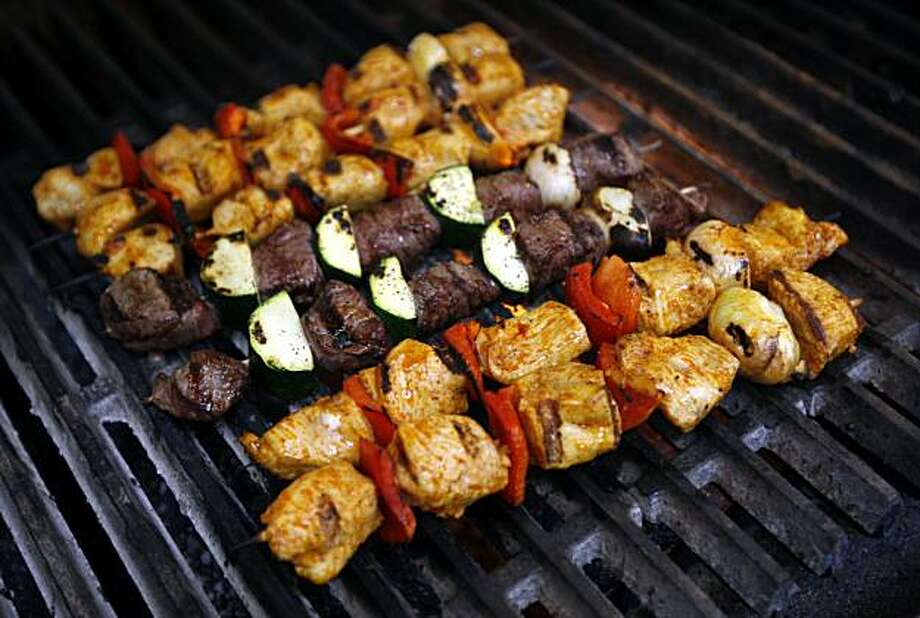 "Lamb and chicken kabobs cook on the grill at ""Falafel, etc."" Middle Eastern restaurant in Fremont, Calif., on Wednesday, March 31, 2010. Photo: Paul Chinn, The Chronicle"