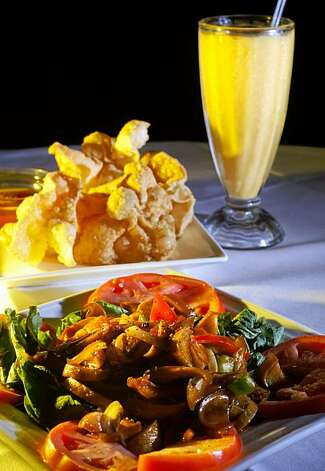 One of the Golden Era Vegetarian restaurant specialties are  Fried Wonton Appetizer, Teriyaki Mushrooms, and the Mango Smoothie, Monday Aug. 10, 2009, in San Francisco, Calif. Photo: Lacy Atkins, The Chronicle